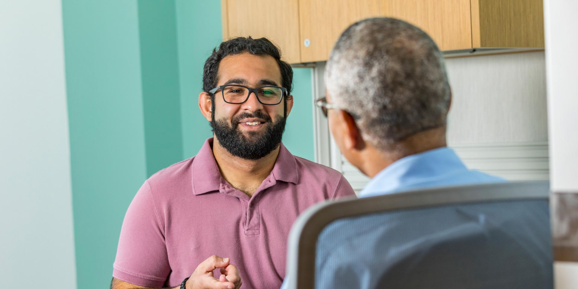 A counselor and patient talk at therapy